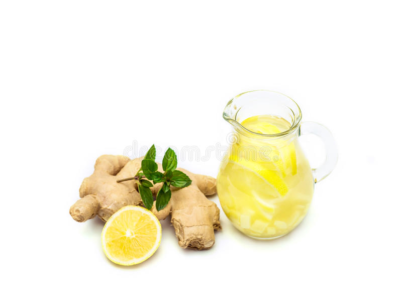 Ginger tea with lemon, ginger root and mint on white background royalty free stock photography