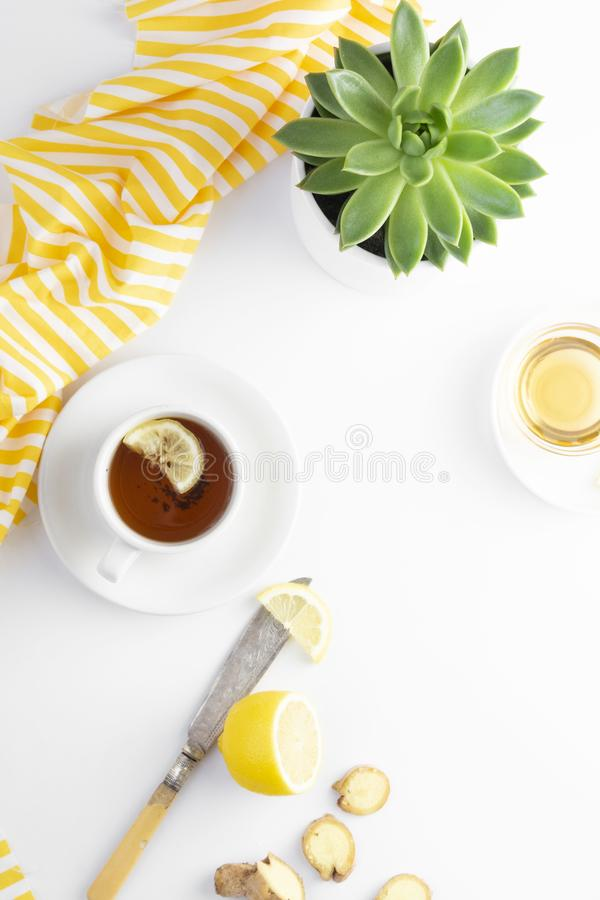 Ginger tea with lemon honey hot autumn, winter drink white background with copy space flat lay royalty free stock images