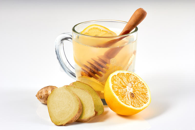 Ginger tea with lemon and honey on white background stock images