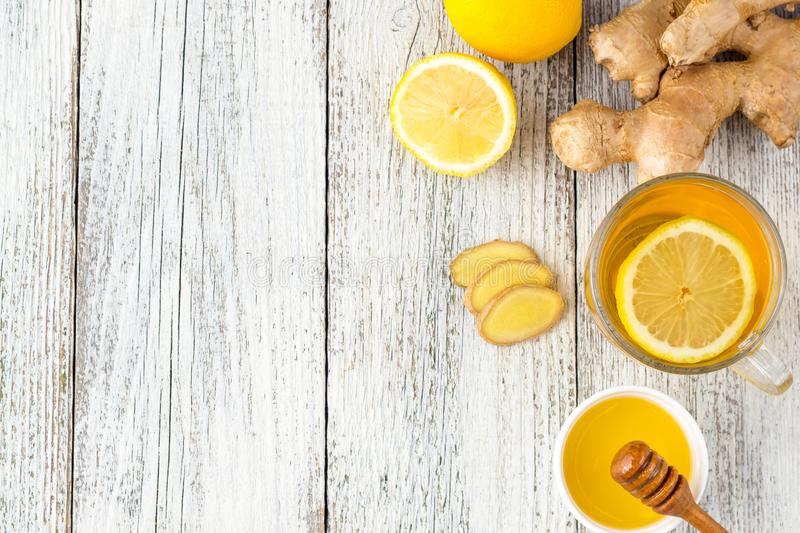 Ginger tea with lemon and honey on a white wooden background. Hot healthy winter drink. With copy space, cup, glass, food, beverage, herbal, fresh, natural royalty free stock images