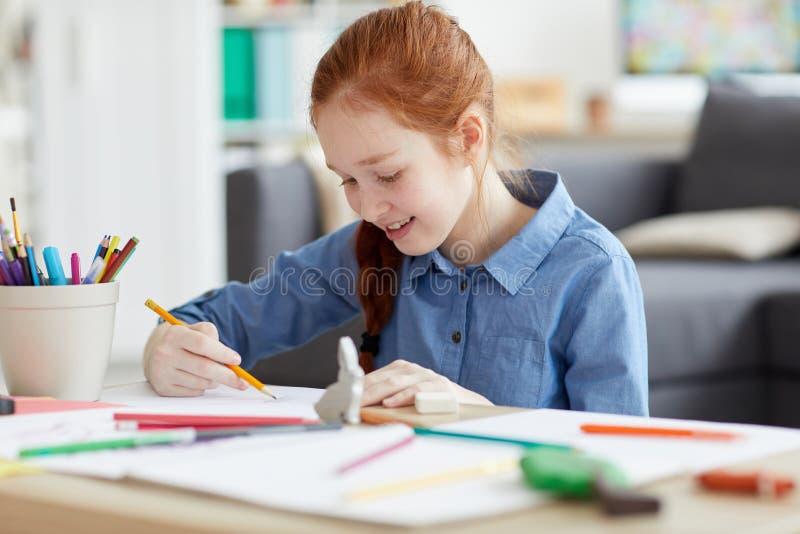 Ginger Teenage Girl Drawing imágenes de archivo libres de regalías