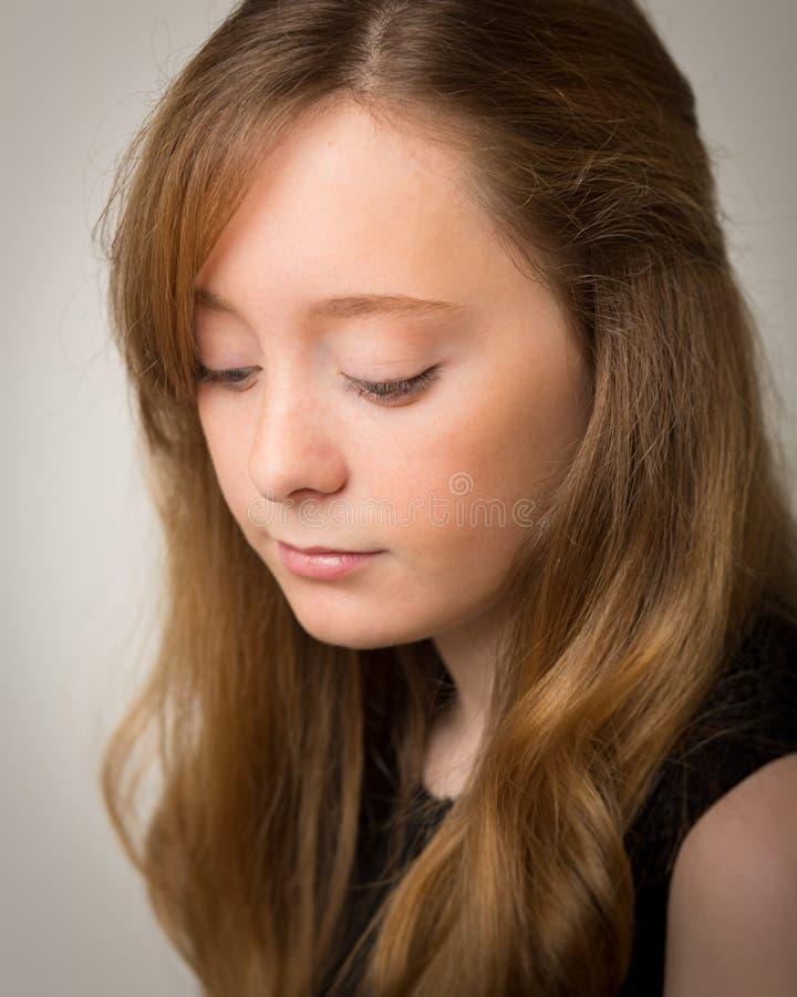 Ginger Teenage Girl Looking Down imágenes de archivo libres de regalías