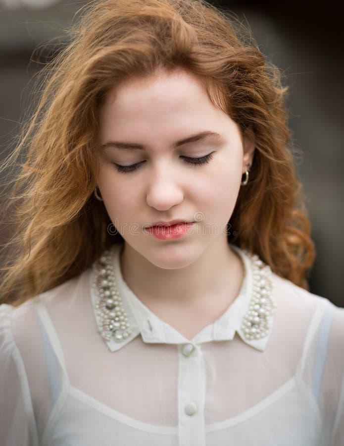 Ginger Teenage Girl Looking Down hermoso imagenes de archivo