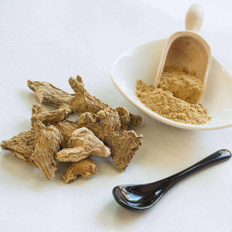 Ginger roots and powder royalty free stock images
