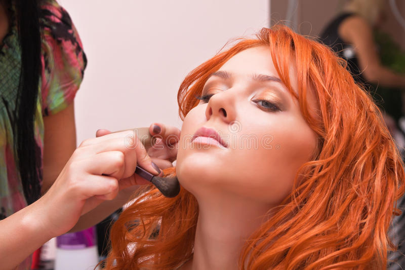 Download Ginger Woman Having Make-up Applied Stock Photo - Image of performing, lips: 15829598