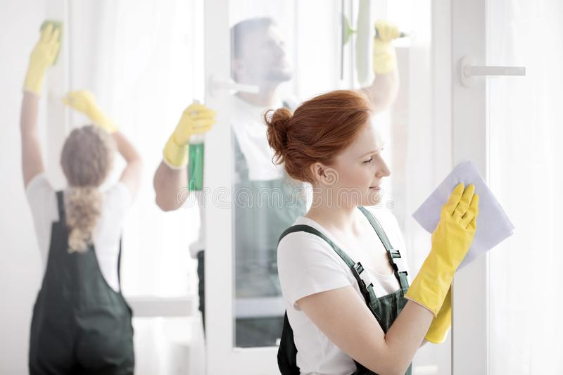 Woman cleaning window royalty free stock photography