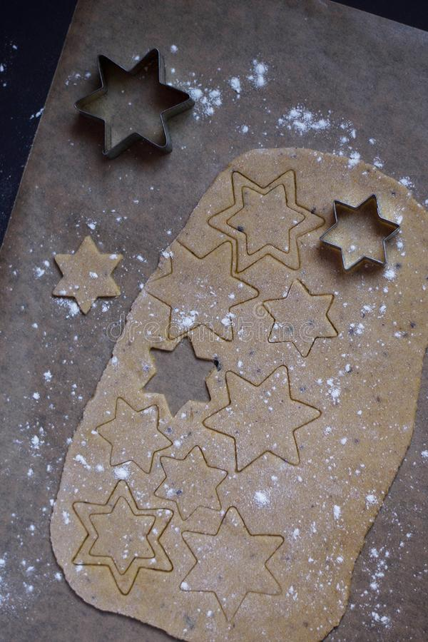 Gingerbread stars preparation for baking royalty free stock photo