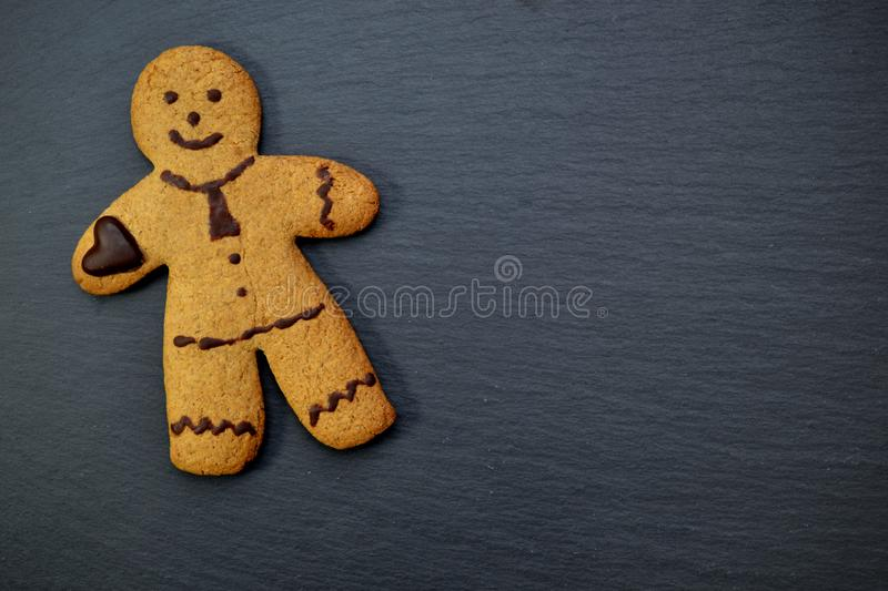 Gingerbread man male little man merry christmas. Gingerbread business man with a Chocolate tie royalty free stock photos