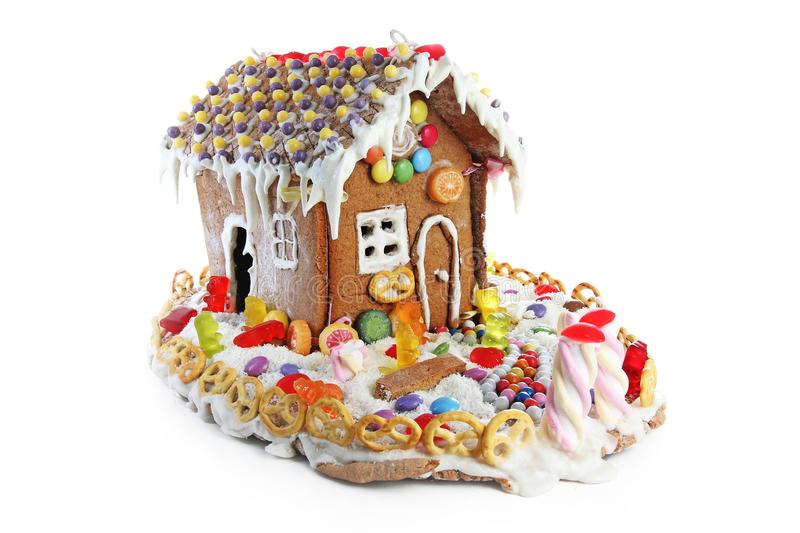 Gingerbread candy sugar house. Fairy tail candyhouse covered with snow and colorful candies Homemade gingerbread house royalty free stock photos