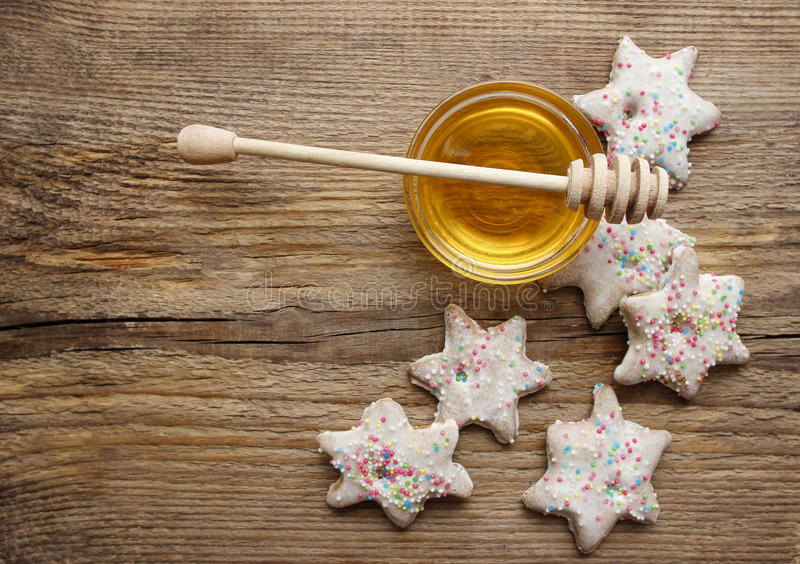 Gingerbread christmas cookies and bowl of honey. On wooden table. Top view, copy space stock photo