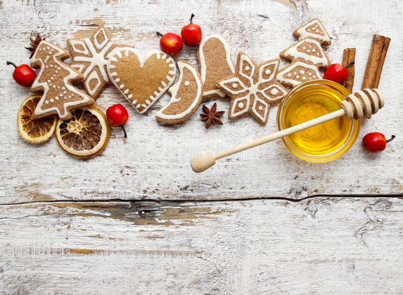 Gingerbread christmas cookies and bowl of honey on wooden table. stock photos