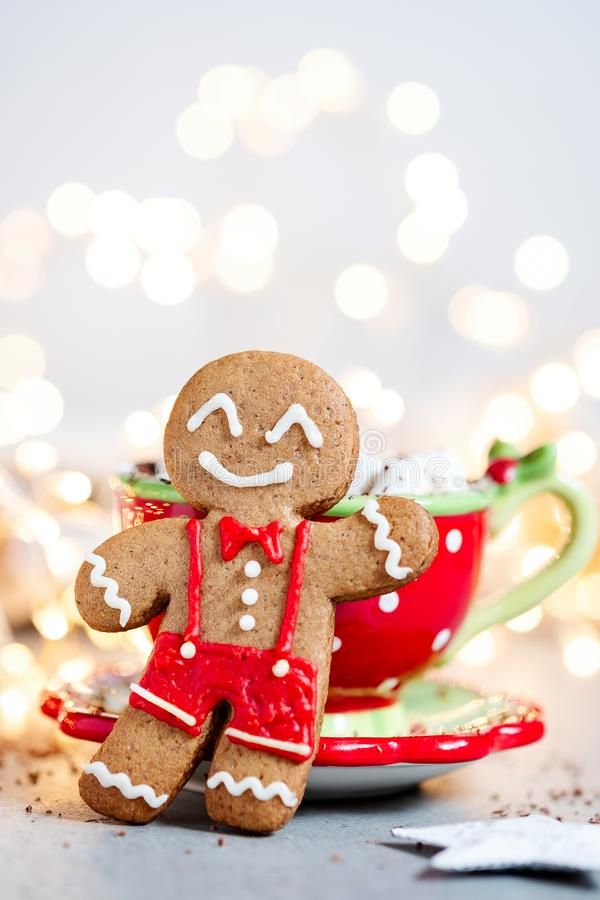Happy gingerbread cookie man. Gingerbread cookie man and hot chocolate with marshmallow royalty free stock photography