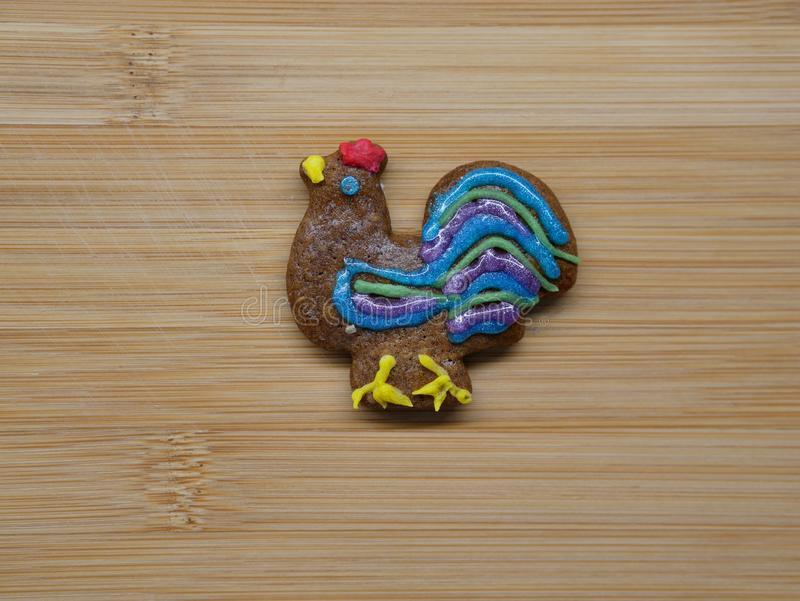 Gingerbread cookie in the shape of a rooster. stock photography