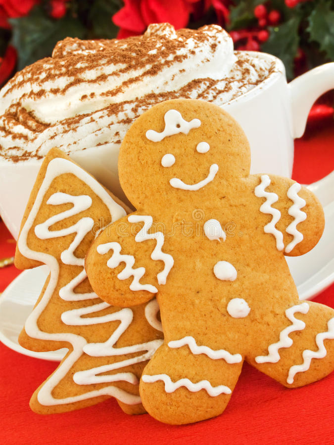 Gingerbread cookies. Homemade gingerbread tree and man cookies and cup of chocolate with whipped cream. Shallow dof royalty free stock photos