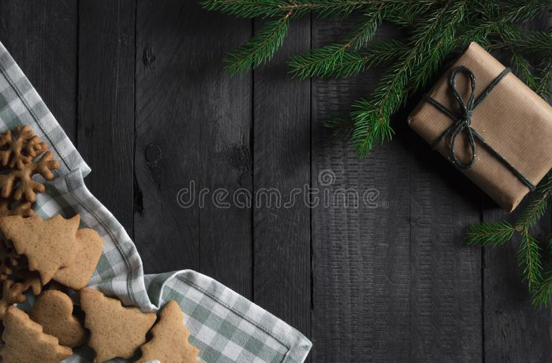 Gingerbread cookies and Christmas gift. Xmas frame with copy space. Top view royalty free stock image