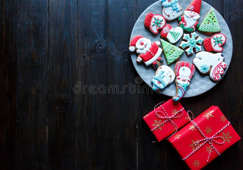 Gingerbread cookies for christmas, new year in kids hands on the wooden table. Festive, sweet pastry, delicious biscuits. Home celebration, decoration concept stock photos