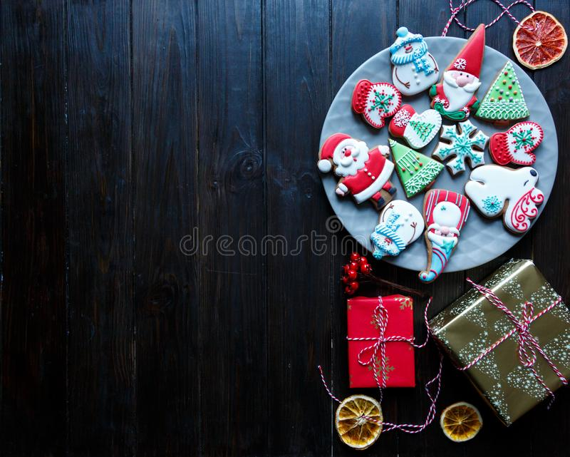 Gingerbread cookies for christmas, new year on the wooden table. Festive, sweet pastry, delicious biscuits. Gingerbread cookies for christmas, new year the stock images