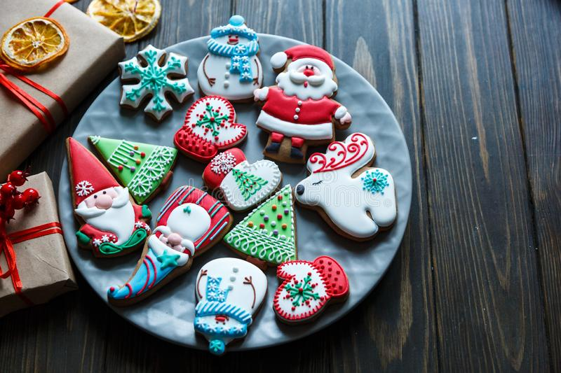 Gingerbread cookies for christmas, new year on the wooden table. Festive, sweet pastry, delicious biscuits. Home celebration, decoration concept stock image