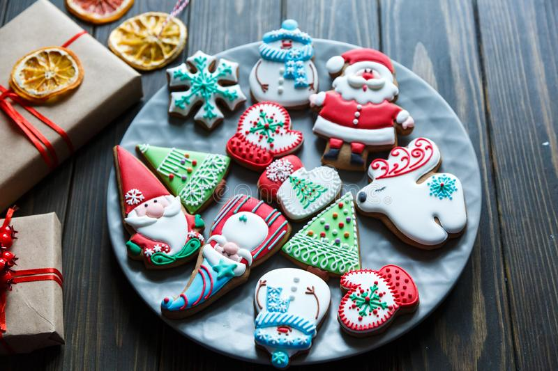 Gingerbread cookies for christmas, new year. On the wooden table. Festive, sweet pastry, delicious biscuits royalty free stock photography