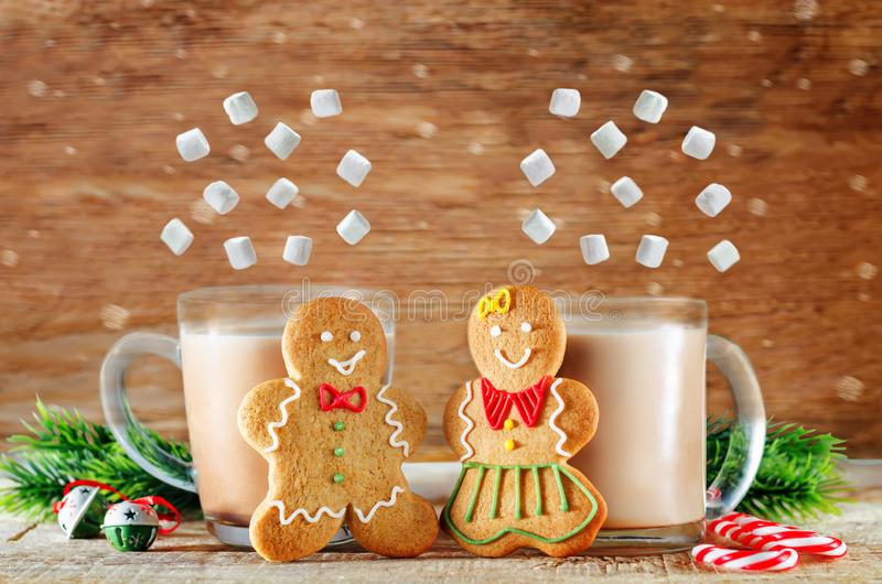 Gingerbread cookies with cocoa on a dark wood background for Christmas isolated. Copy space stock images