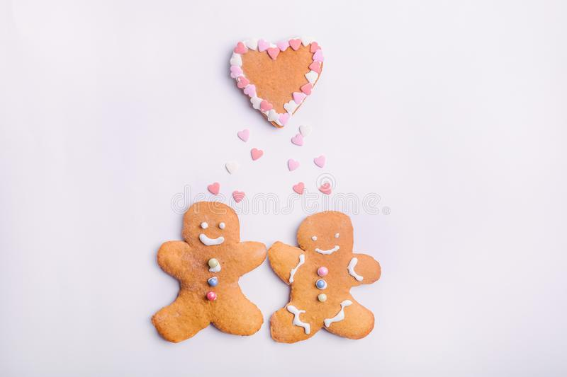 Gingerbread cookies couple for Valentines Day. Man and woman with emotions in the shape of hearts on the white background. Love an royalty free stock images
