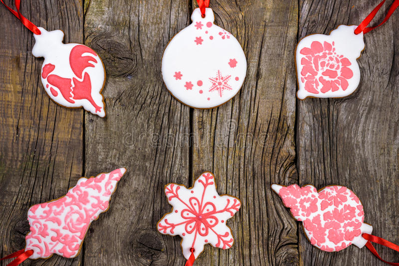 Gingerbread cookies hanging over wooden background. Copy spase royalty free stock image