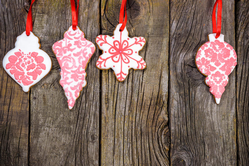 Gingerbread cookies hanging over wooden background. Copy spase stock image