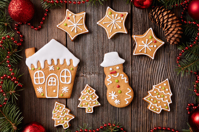 Gingerbread cookies house, fir trees, stars and royalty free stock photography