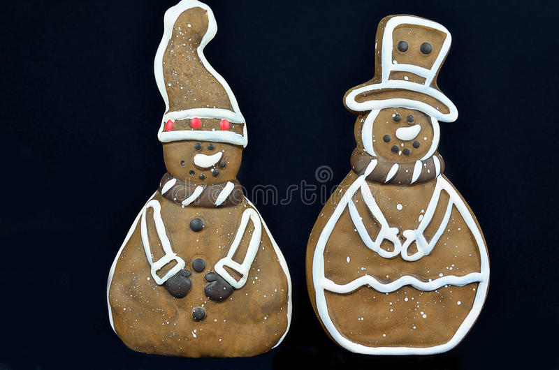Gingerbread Cookies, isolated on Black. Two gingerbread cookies, isolated on black, close up stock photo
