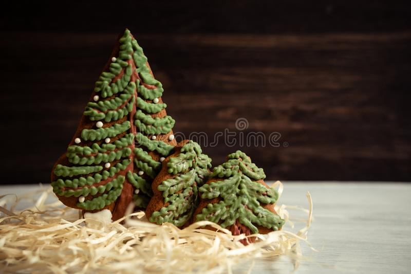 Gingerbread cookies are made by hand for Christmas in the form of tree stock image
