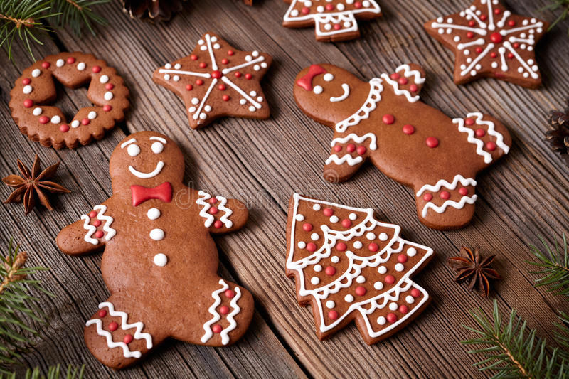 Gingerbread cookies man and woman couple christmas. Holiday composition with icing on vintage wooden table background. Traditional homemade dessert food recipe stock photos