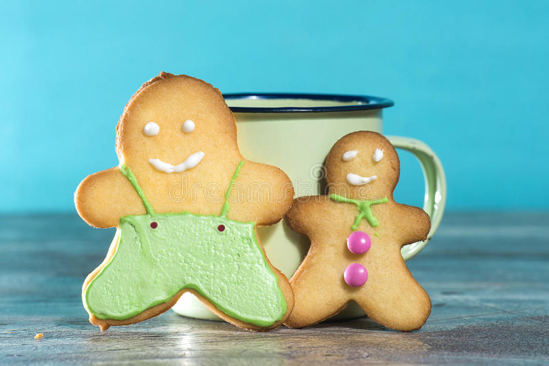 Gingerbread cookies and milk. With blue background stock images