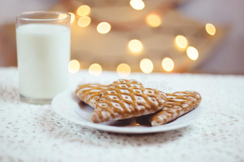 Gingerbread cookies and milk stock photography