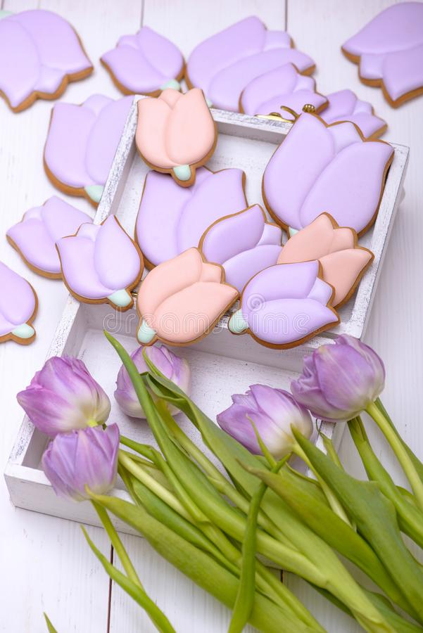 Gingerbread cookies in the shape of flower and purple tulip stock photos