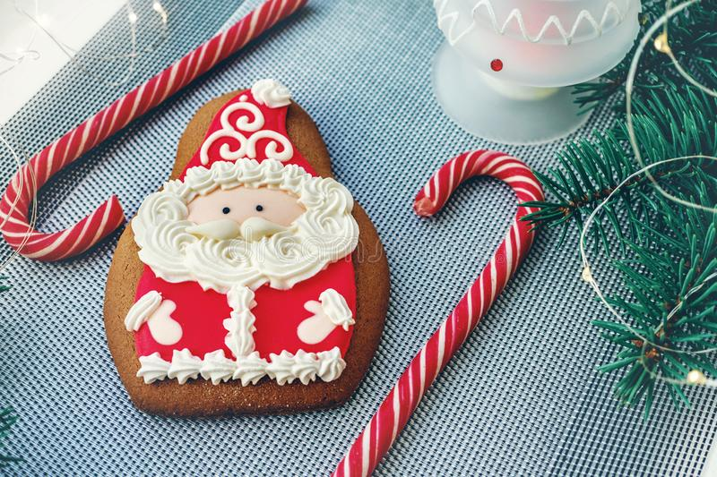 Gingerbread Cookies In The Shape Of Santa Claus. Handmade cookies, cakes and caramel canes for Christmas and New year royalty free stock images