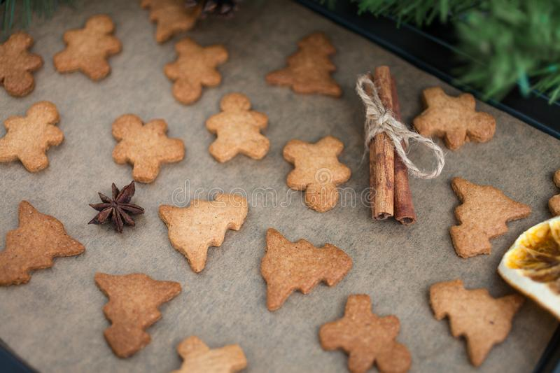 Gingerbread cookies with spices. Gingerbread cookie man and Christmas trees. Festive Christmas baking. Winter background royalty free stock image