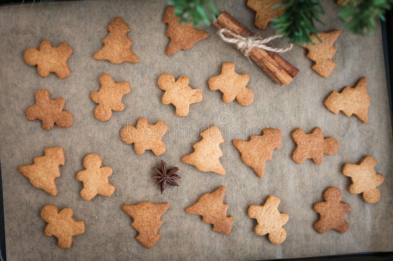 Gingerbread cookies with spices. Gingerbread cookie man and Christmas trees. Festive Christmas baking. Winter background stock photos