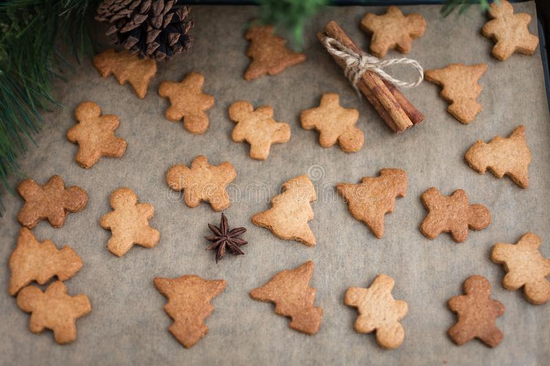 Gingerbread cookies with spices. Gingerbread cookie man and Christmas trees. Festive Christmas baking. Winter background stock image