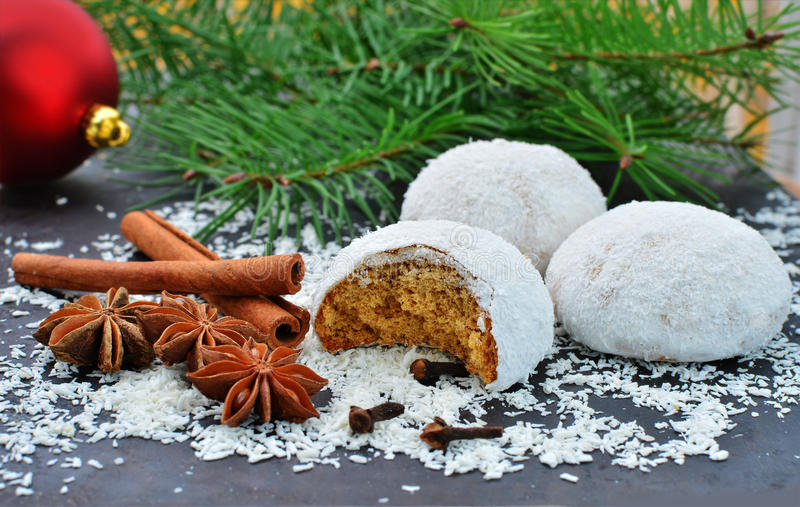 Gingerbread cookies with sugar icing and coconut flakes. For Christmas stock photos