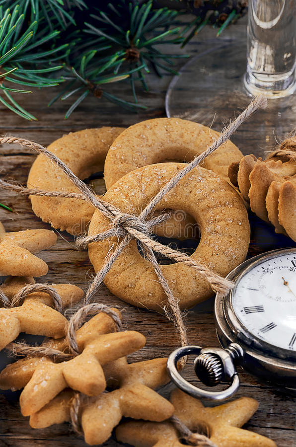 Gingerbread cookies and vintage swiss watch royalty free stock photos