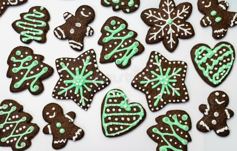 Gingerbread cookies on white background. Snowflake, star, man, heart shapes. Gingerbread cookies on white background. Snowflake, star, man, heart shapes Top royalty free stock photo