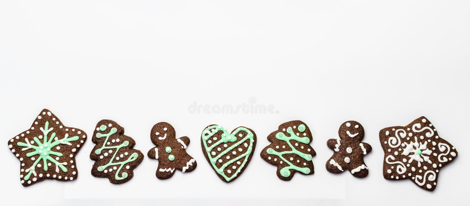 Gingerbread cookies on white background. Snowflake, star, man, heart shapes. Top view Christmas background royalty free stock photography