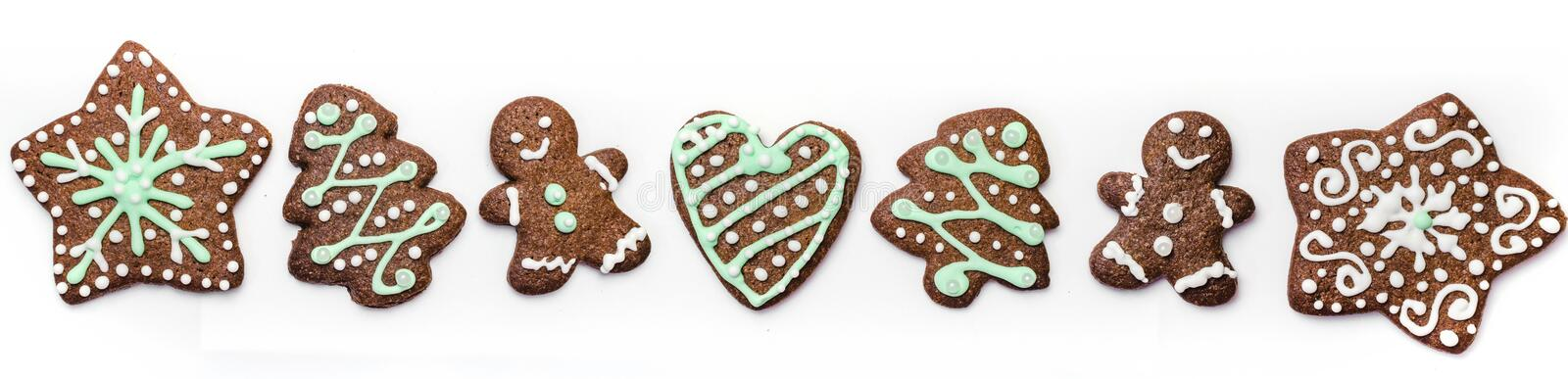 Gingerbread cookies on white background. Snowflake, star, man, heart shapes. Top view Christmas background royalty free stock image
