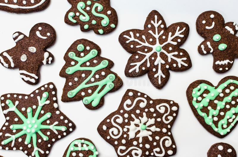 Gingerbread cookies on white background. Snowflake, star, man, heart shapes. Top view Christmas background stock photos