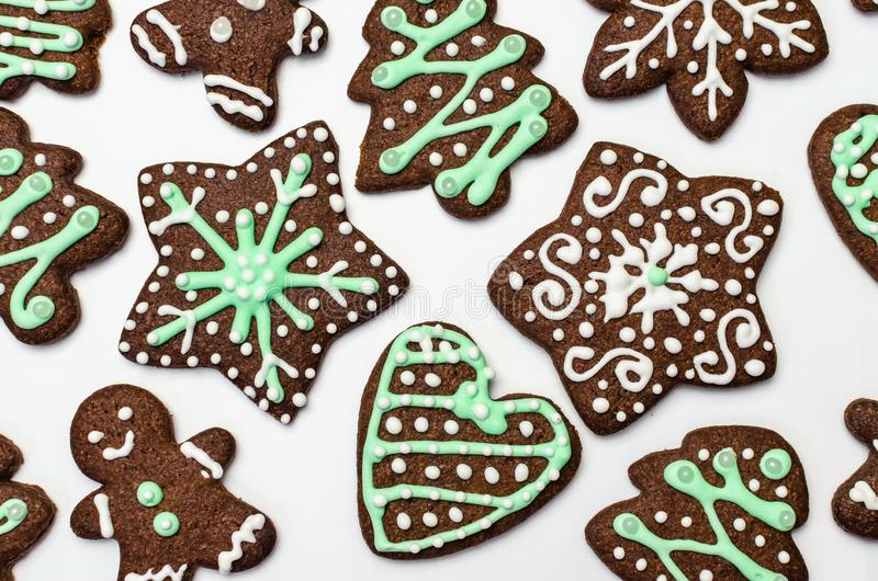 Gingerbread cookies on white background. Snowflake, star, man, heart shapes. Top view Christmas background stock photography