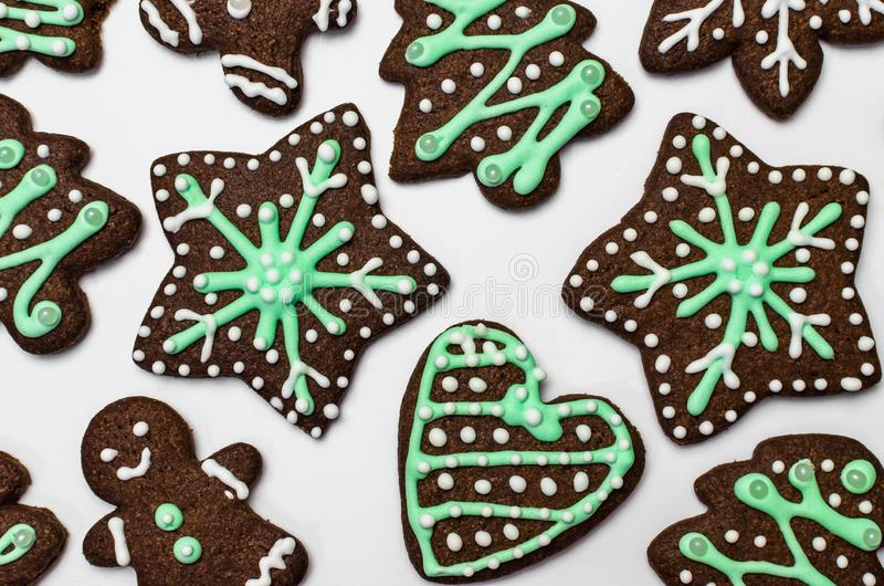 Gingerbread cookies on white background. Snowflake, star, man, heart shapes. Top view Christmas background stock image