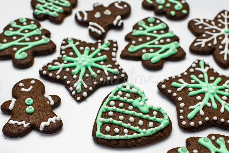 Gingerbread cookies on white background. Snowflake, star, man, heart shapes. Gingerbread cookies on white background. Snowflake, star, man, heart shapes Top royalty free stock images