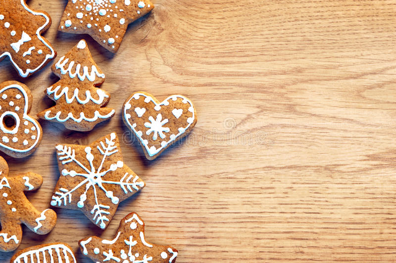 Gingerbread cookies on wooden table. Merry Christmas and Happy New Year!!. Gingerbread cookies on wooden table. Close up, top view. Merry Christmas and Happy New royalty free stock photo