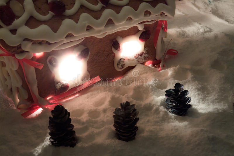 Gingerbread cottage with snow and cones