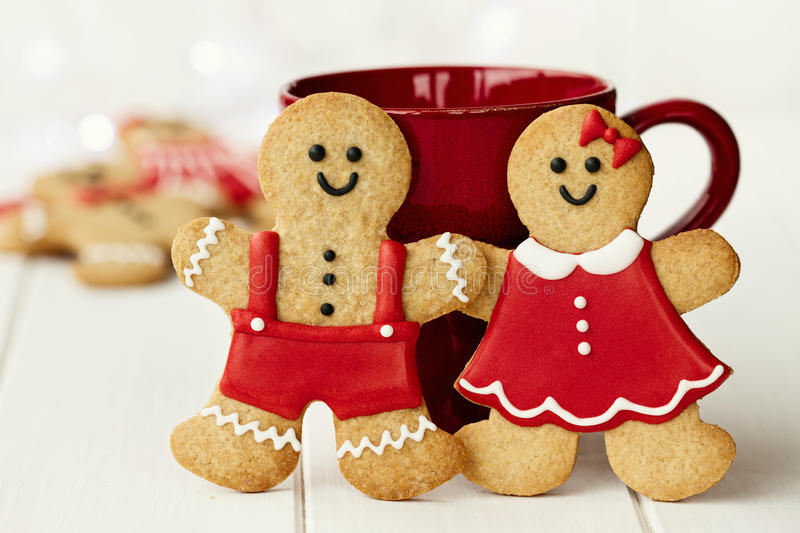Gingerbread couple. Gingerbread man and lady with mug royalty free stock photo